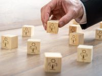 Customer-Managed Relationship Concept - Businessman Arranging Small Wooden Blocks with Symbols on the Table.